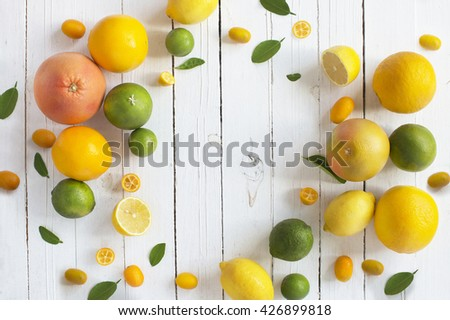 Citrus fruits family on rustic white wooden background. Horizontal view. Text space images.  - stock photo