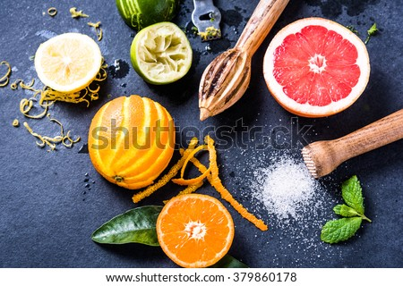 Citrus fruits for summer refreshing lemonade, lay flat from overhead. Ingredients for healthy drink. - stock photo