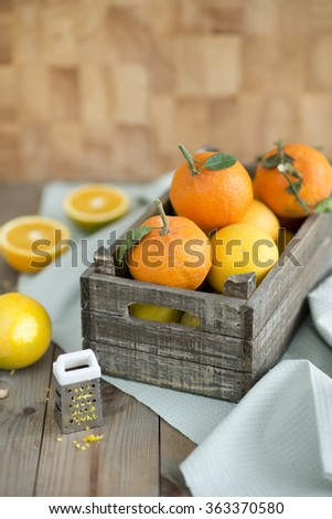 Citrus fruits in a wooden box - stock photo