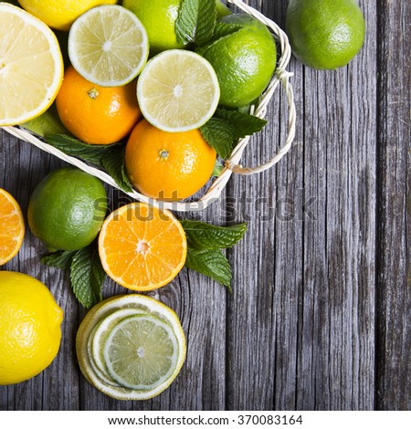Citrus fruits in basket - stock photo