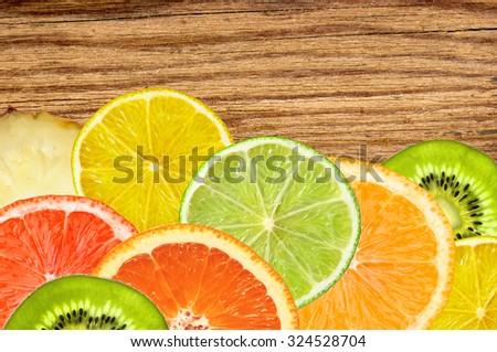 citrus fruits of lemon, orange, grapefruit, lime on wooden texture  - stock photo