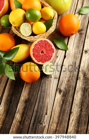 Citrus fruits on a brown wooden table - stock photo