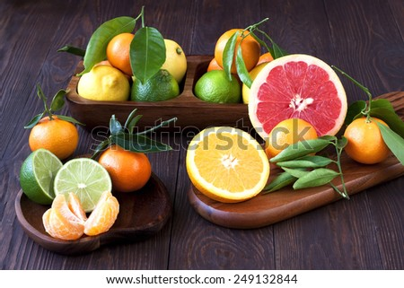 Citrus fruits on wooden background - stock photo