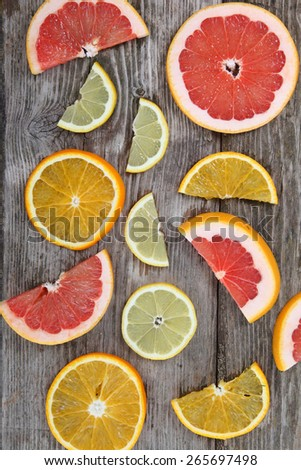 Citrus fruits. Oranges, grapefruits and lemons on a wood table background - stock photo