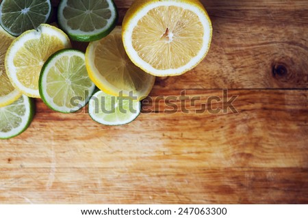 Citrus fruits. Oranges, limes and lemons. Over wood table background with copy space with shallow depth of field - stock photo