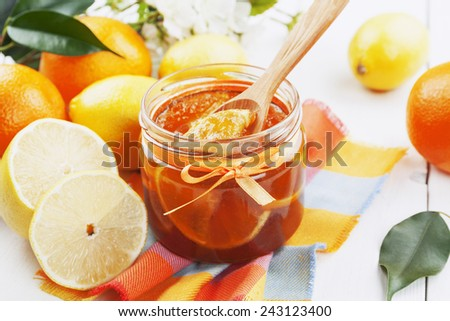 Citrus jam in the glass jar on the wooden table - stock photo