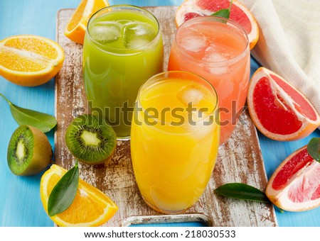Citrus juice   on a wooden board. Selective focus