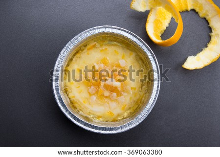 Citrus, lemon and orange mini pie on aluminum cups on metal background - stock photo