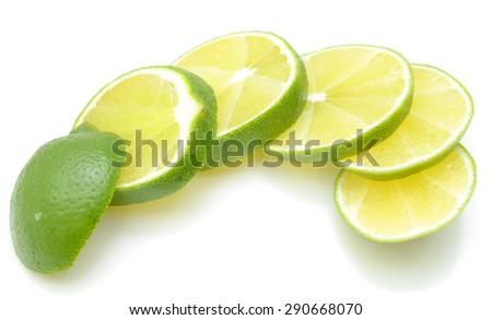 Citrus lime fruit segment isolated on white - stock photo