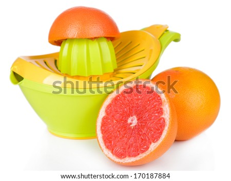 Citrus press and grapefruits isolated on white