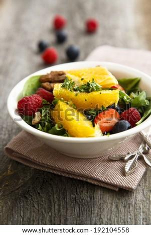 Citrus salad with berries - stock photo