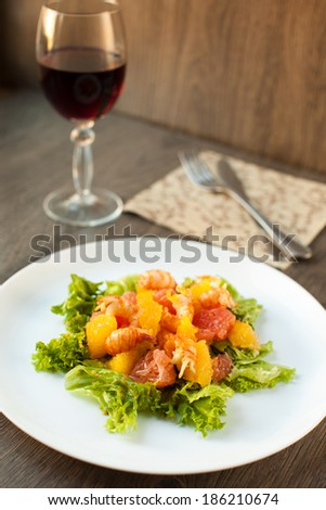 Citrus salad with crayfish - stock photo