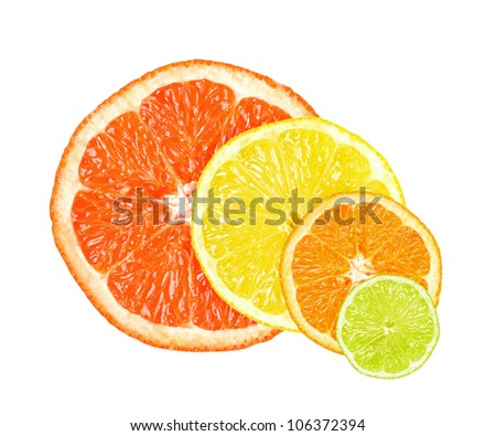 Citrus slices in four colors and sizes isolated on white background. - stock photo