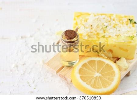 Citrus soap bar, aroma oils, herbal sea salt. Aromatherapy and body care. - stock photo