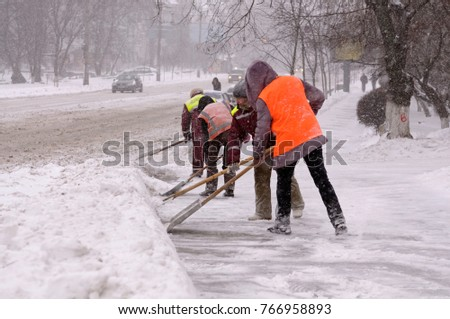 City after blizzard. Municipal workers removing snow and ice from streets of Kyiv. January 12, 2016. Kyiv, Ukraine.