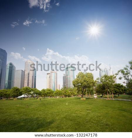 city and grass with blue sky - stock photo
