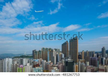 City and plane in the blue sky, blur concept.