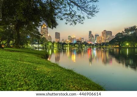 City at night view of Bangkok from Lumpini Park, Thailand - stock photo