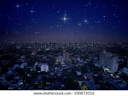 city at night with stars in the sky