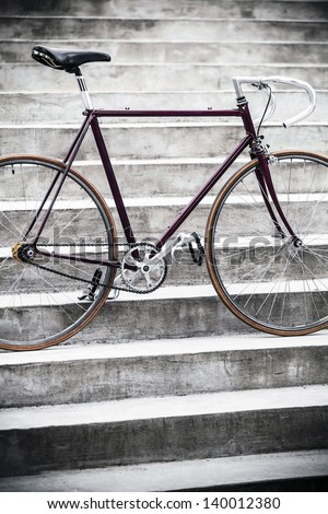 City bicycle fixed gear and concrete stairs - stock photo