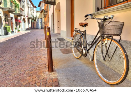 City bicycle on the cobbled street of Alba in Piedmont, Northern Italy.