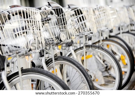 City bicycles with front basket are seen in a rental point - stock photo