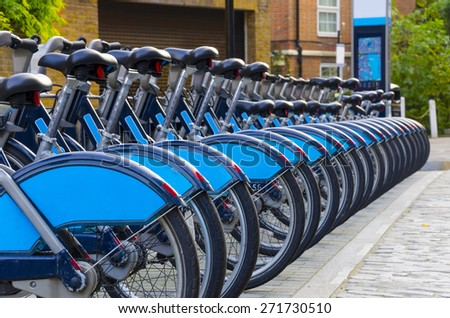 "City Bike Rental - Stock Image, a row of bikes for hire as part of a new scheme to encourage ""pedal power"" in the City of London.  - stock photo"