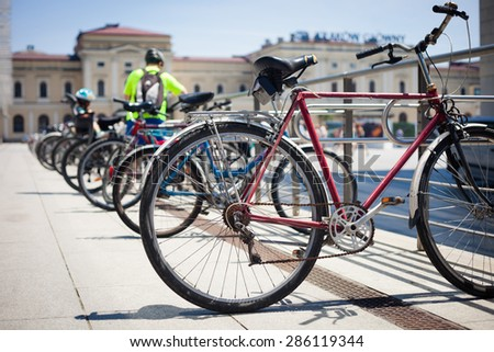 City bikes parked in a row - stock photo