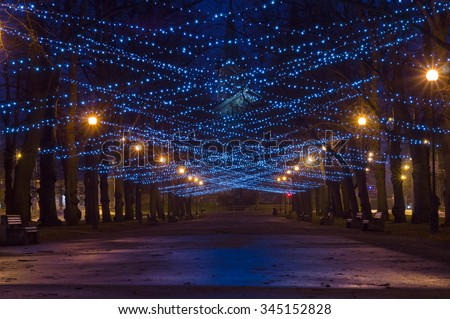 City boulevard decorated with New Year and Christmas illumination - stock photo