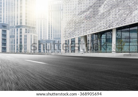 City building street scene and road surface - stock photo