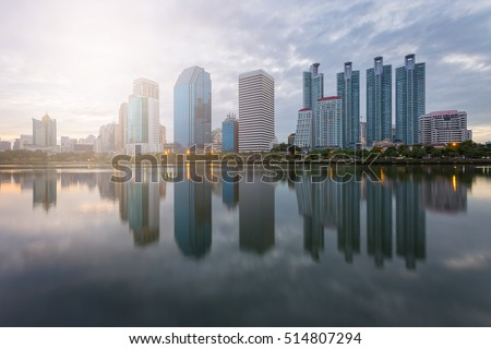 City building with water reflection before sunset background