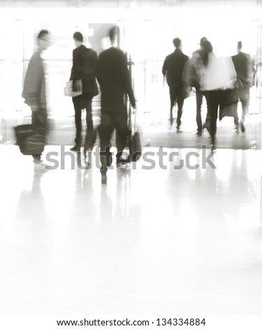 city business people moves in the office lobby, abstract blurred motion?Black and white images - stock photo