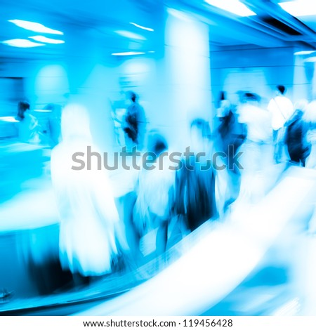 city business people on escalator abstract blur - stock photo
