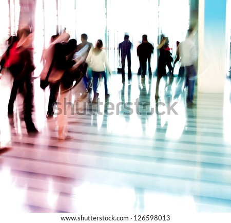 city business people walking in the lobby blur motion
