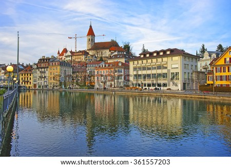 City Church and Embankment in the Old City of Thun. Thun is a city in Swiss canton of Bern. It is located where Aare river flows out of Lake Thun (Thunersee).