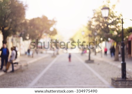 City commuters. Abstract blurred image of a city street scene. - stock photo