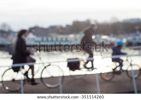 City commuters. High key blurred image of people crossing contemporary bridge in business district . Unrecognizable faces. - stock photo