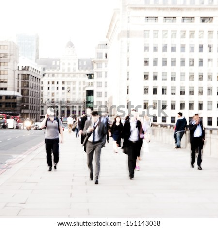 City Commuters. High key blurred image of workers walking in the city. Unrecognizable faces, bleached effect. - stock photo