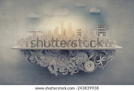 City construction model with cogwheel mechanism on grunge background - stock photo