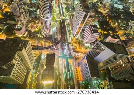 City downtown at night, Bird eyes view of Bangkok main traffic interchange, Long exposure - stock photo