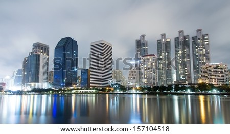 City Downtown at Night with Building Reflection in the River.