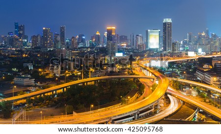 City downtown background and highway interconnection night view, at twilight