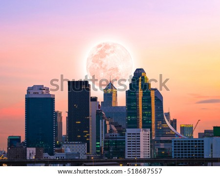 city downtown in the sunset time with full moon, element of this image furnished by NASA