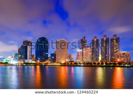 City downtown skyline at night with water reflection, Bangkok,Thailand - stock photo