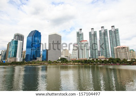 City Downtown with Building Reflection in the River.
