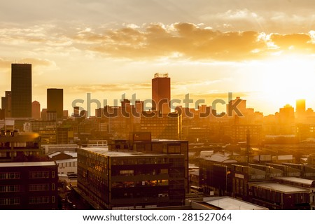 City during warm sunset - stock photo