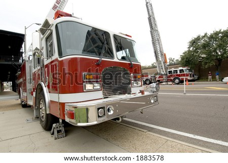 City firetrucks on a call in a downtown area - stock photo