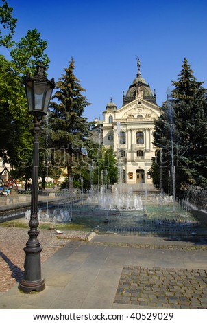 City Hall of slovakian city Kosice with fountains and lantern in front of it
