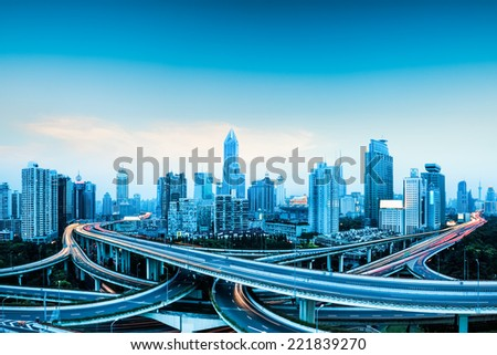 city highway overpass panoramic with shanghai skyline, modern traffic background  - stock photo