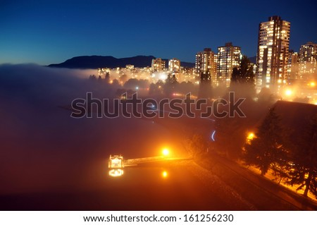 City In Heavy Fog At Night      - stock photo